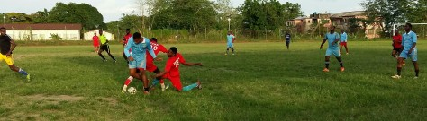 Men in action; players scuffle for the ball